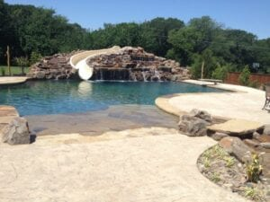 huge rock sculpture and slide into a pool