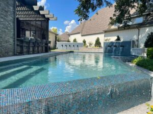 infinity pool with blue glass tile