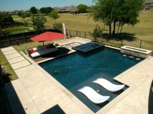 pool with spa and tanning ledge