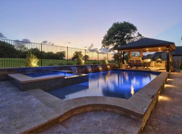 image of a new pool at dusk with a patio in the background