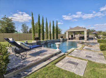 image of a residential pool and outdoor kitchen