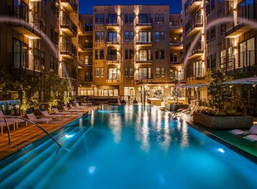 image of a commercial pool at an apartment at night