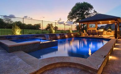 image of a pool at dusk with a patio in the background
