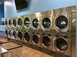 a row of stacked laundry machines