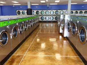two rows of laundry machines