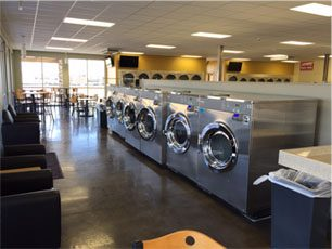 a row of laundry machines