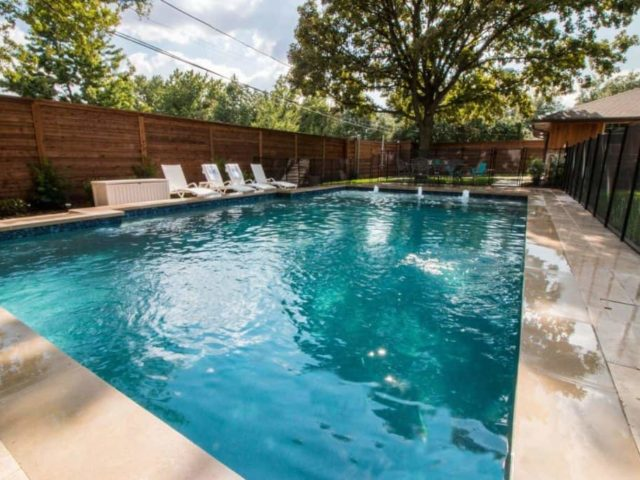 Backyard Pool with Splash Pad for Family Fun