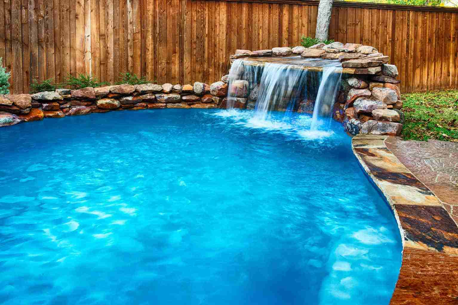 Beautiful custom swimming pool with water feature