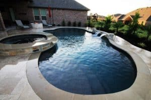 Free form pool with spa and water feature