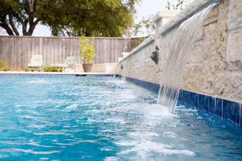Close-up of a pool with a water feature