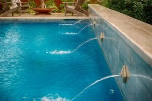 Modern pool with fountains