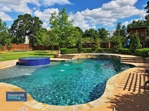freeform pool with glass tile spa