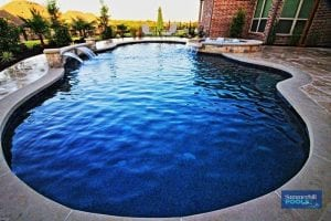 Freeform pool with water feature and spa