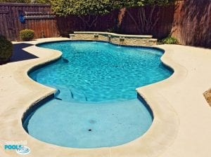 freeform pool with wall of scuppers