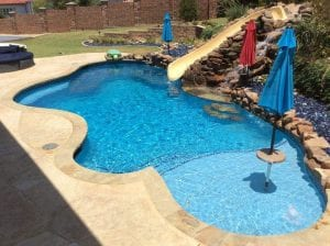 freeform pool with water slide