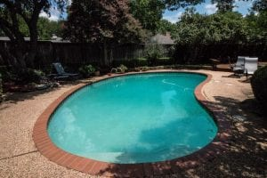 before renovation of a simple freeform pool