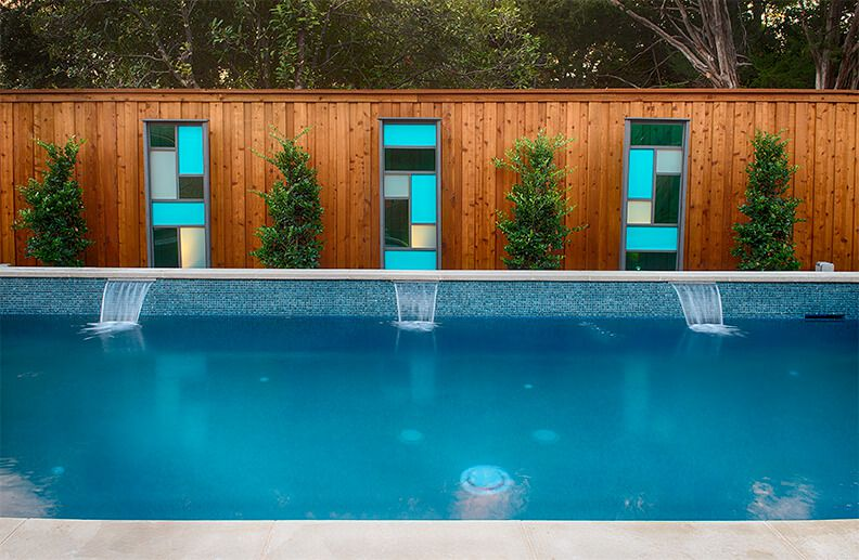 Beautiful rectangular modern pool with water fountaints