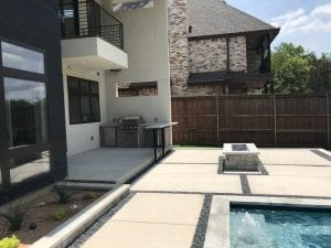 modern backyard with brand new fire pit and kitchen area