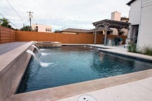 rectangle pool with spa and scuppers