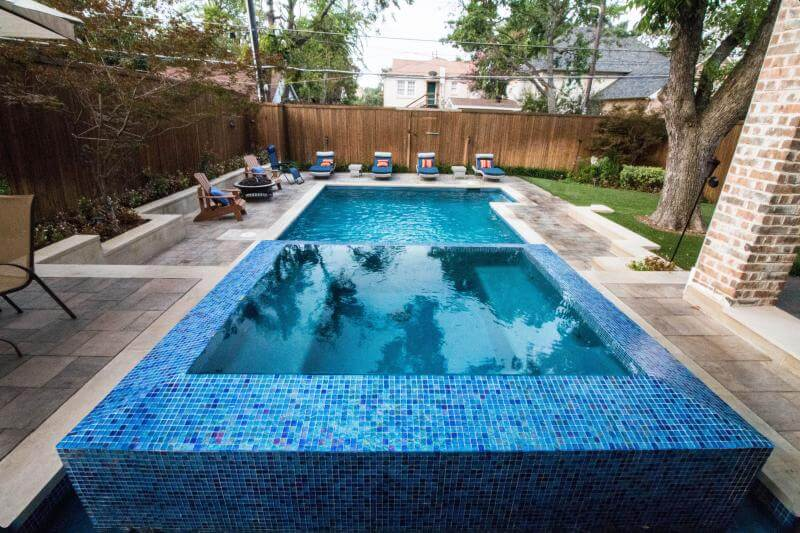 Beautiful two-level rectangular pool with blue tilework
