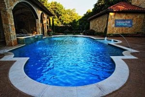 traditional pool with water features