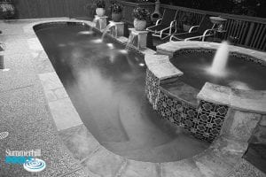 black and white photo of a oval shaped pool