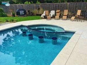 swim up bar with black tile in pool