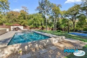 beautiful backyard pool with concrete coping and decking