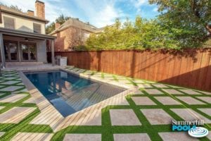 beautiful rectangle concrete pool with stone pavers