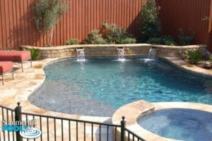 free form pool with stone water wall