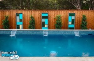 beautiful glass tile wall in a backyard pool
