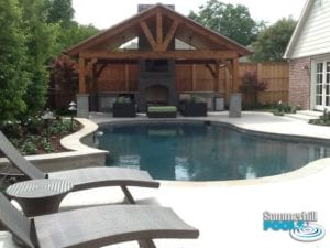 outdoor kitchen and backyard pool