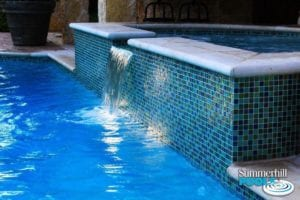 glass tile spa with water feature