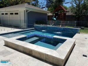 small pool with glass tile raised wall