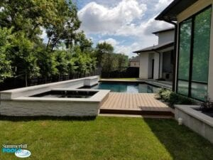 new pool with wood decking