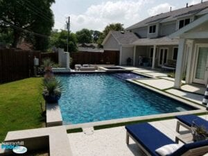 new modern pool with concrete paver decking