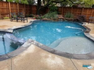 new pool construction with rock waterfall