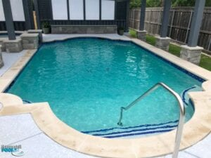 renovated pool with blue tile on steps