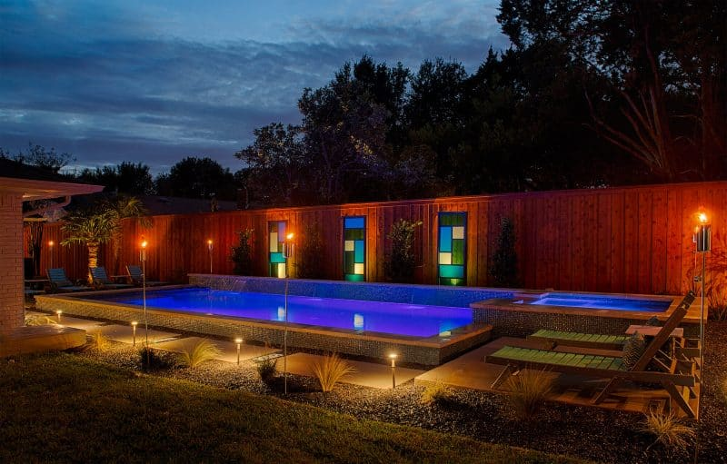This colorful modern pool glows at dusk in Dallas.