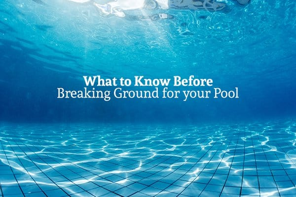 """A view from underwater in a pool with the words """"What to Know Before Breaking Ground for your Pool"""""""