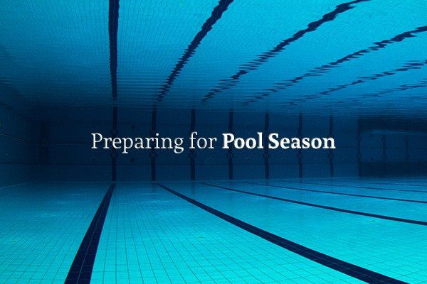 "Picture of an Olympic sized pool from the perspective of someone under water, with the words ""Preparing for Pool Season"""